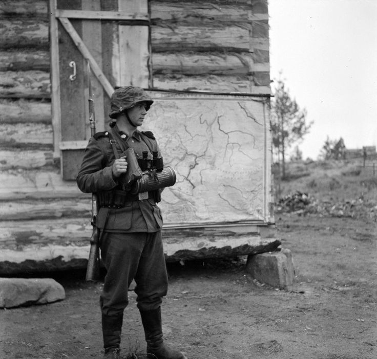 """A soldier of the SS Division """"Totenkopf"""" on post. Salla, Finland. 1941."""
