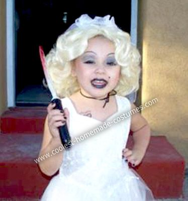 Homemade Bride of Chucky Child Costume: My 3 year old wanted to be something scary this Halloween. She had dressed as Chucky when she was 1 yr old. One day, as I was putting makeup on her face,