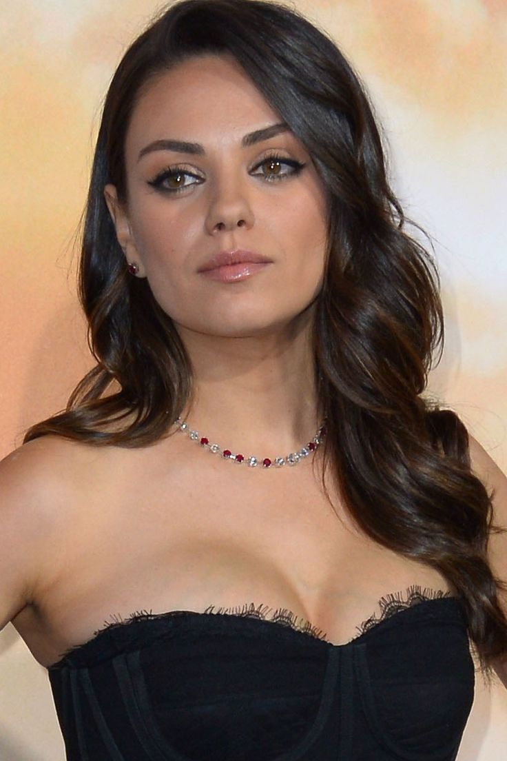 Mila Kunis wore her long brown hair in loose curls at the Jupiter Ascending film premiere; the perfect accompaniment to her Dolce & Gabbana dress.