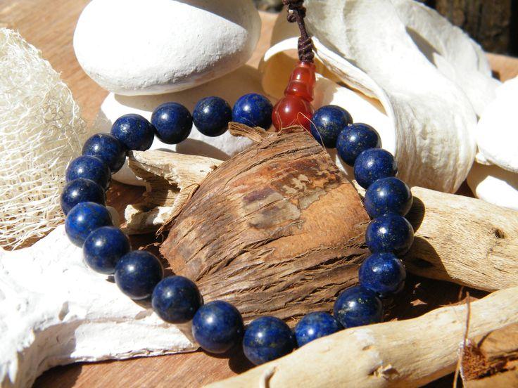http://www.tibetan-shop-tharjay-norbu-zangpo.hu/mala/feldragako_mala_71/kezi_gumis_94/lapisz-lazuli-karmala-karneol-guruval-21-szemes-ferfias-darab