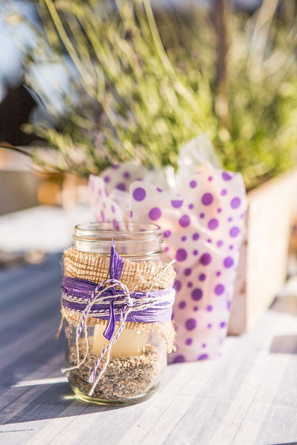 eco-friendly table decor #ecofriendlywedding #purplewedding #weddingchicks http://www.weddingchicks.com/2014/01/10/lavender-and-white-wedding/
