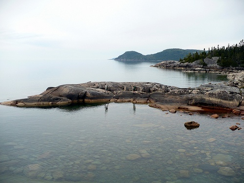 I miss this beautiful place.  Lake Superior Provincial Park ~ Coastal Trail.  Roger and Al out on the rocks taken from our campsite on a rock point across the mouth of a stream.