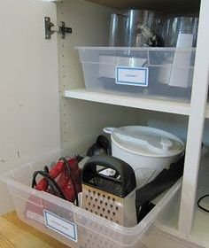 Why didn't I do this on a bigger scale?Place items inside a plastic tub before storing them in your cabinets. No more digging for the stuff in the back.