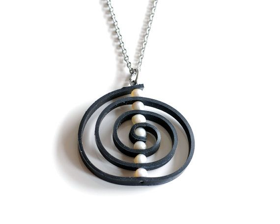 white circle necklUpcycled inner tube spiral pendant. Large black &ace handmade from bike rubber, freshwater pearls and stainless steel.