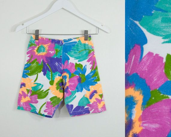 1980s vintage Danskin bike shorts. Floral print on white cotton lycra fabric. Great under a short skirt or dress... or worn alone. Made in the USA Circa: 1980s Label: Danskin Size tag: Medium Modern Size: Small - Medium (review measurements below to ensure a great fit)