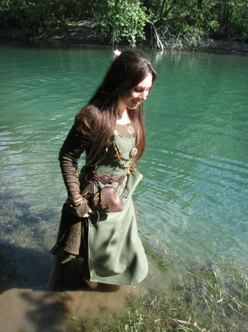 voiceofnature:  Wading in the beautiful turquoise river with her viking dress :)