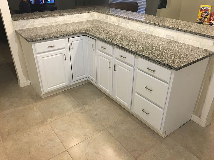 kitchen remodel by granite perfection in orlando with caledonia granite countertops and full backsplash tiles installation