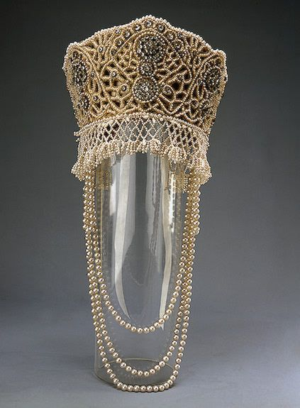 Kokoshnik accessory for a fancy Court ball dress of Princess Elena Golitzine celebrating the Romanov's 300th Dynasty Anniversary, circa 1903.  Made of satin, brocade, lace, fake pearls, rhinestones, sequins, metallic thread;; sewing, embroidery. 14 x 16 cm.