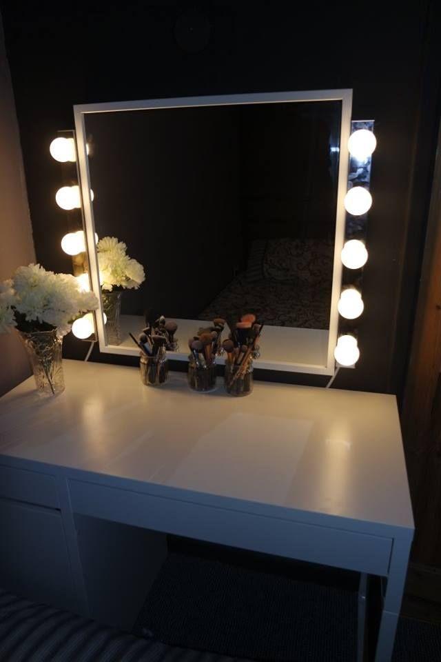 My vanity/makeup station set up :) ikea Micke desk, stave mirror, ledjso bulbs. vanity, makeup station, mirror, lights, oldhollywood, makeup room inspo, brush holders, flowers