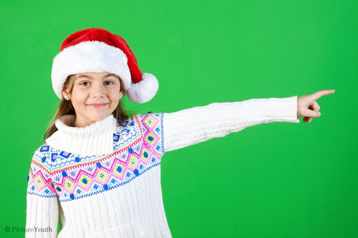 Child in holiday Santa cap pointing.  #custom photography  PictureYouth.com