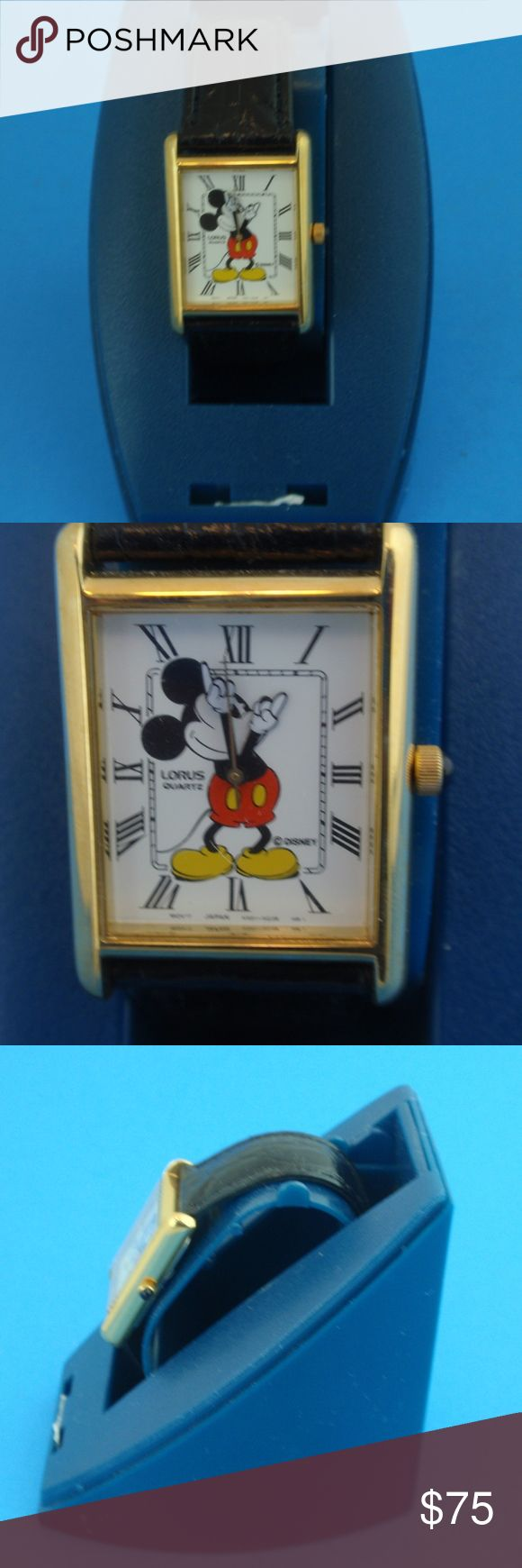 LORUS Quartz Disney Mickey Mouse Watch Rectangular For you Disney and Mickey Mouse lovers, we offer this LORUS collectible quartz watch for your consideration with attractive rectangular face and black pebbled watch band.  Condition:    This is new - never off the stand - however it is old stock so may need a new battery - not included. LORUS Accessories Watches