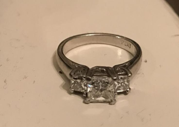 Ladies platinum diamond engagement. This is a 1.52 total carat platinum ring with a princess-cut 1.02 carat diamond center stone. It has side stones totalling 1/2 carat on each side of the center diamond. The purchase price for the diamond ring is $7,500 (also insurance replacement estimated value). So this is a significant savings on this ring! The center stone looks extremely bright and clear in person and ring feels very solid in weight.