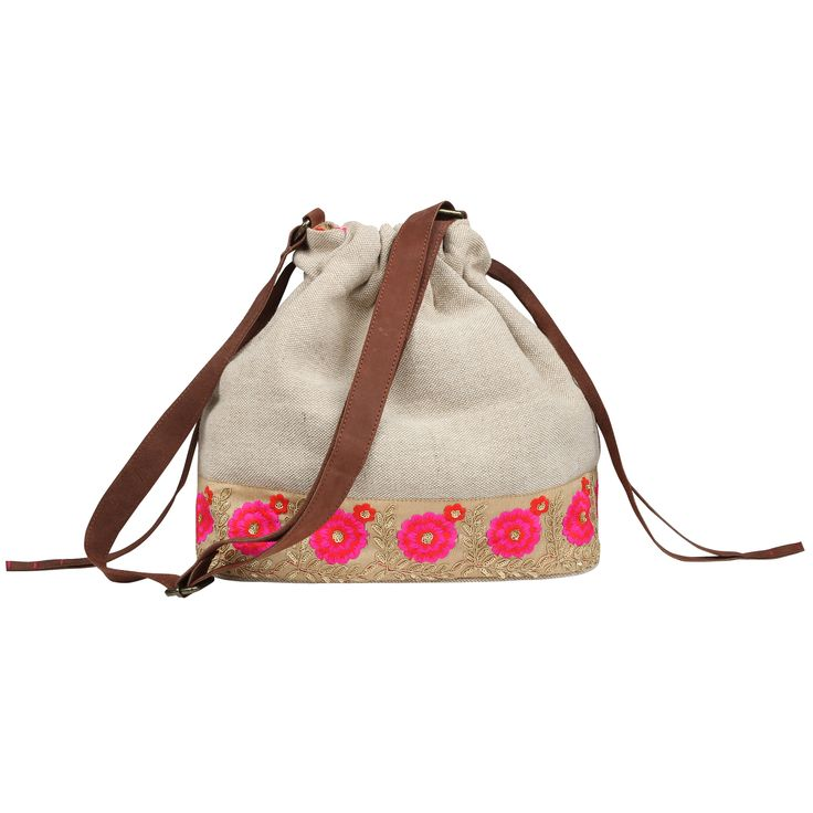 Stylish handmade organic sling with a leather strap and a contrast lined interior.
