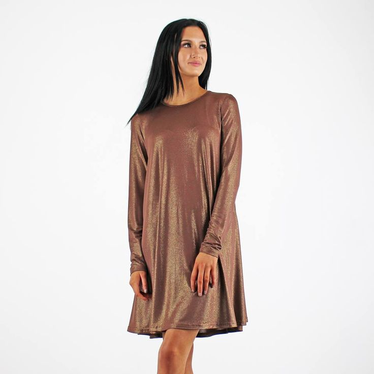 Great little swing dress with a gold shimmer. Instore and also online SHOP with this link for more new arrivals ....http://www.pinkcadillac.co.uk/Glamorous-Gold-Brown-Lurex-Long-Sleeve-Round-Neck-Swing-Dress