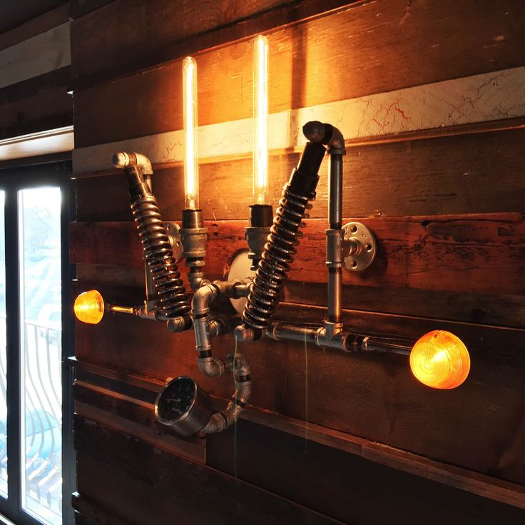 Wall sconce made of used motorcycle parts #gaspipe #motorcycle #parts #light #steampunk #wallsconce