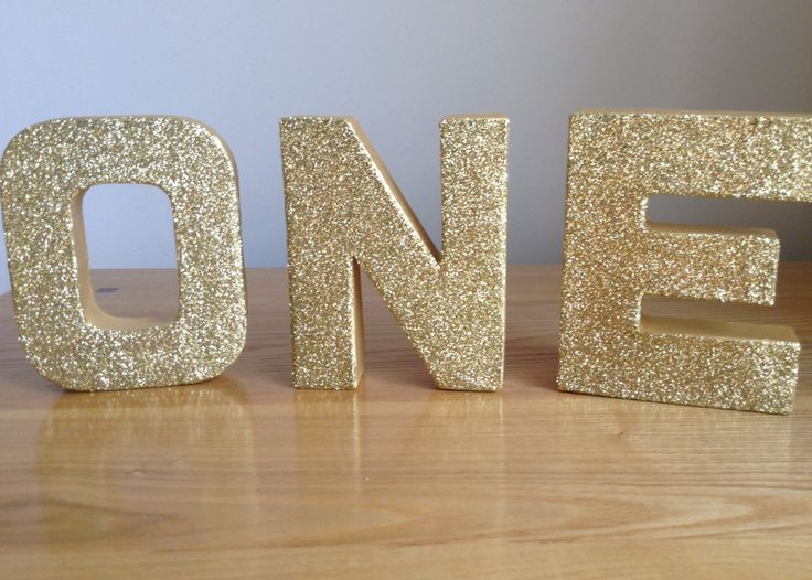 Gold Glitter Letters, ONE Freestanding/Stand-alone Gold Letters, 1st Birthday Party Decor, Gold Paper Mâché Letters by Cardoodle on Etsy https://www.etsy.com/listing/219573412/gold-glitter-letters-one