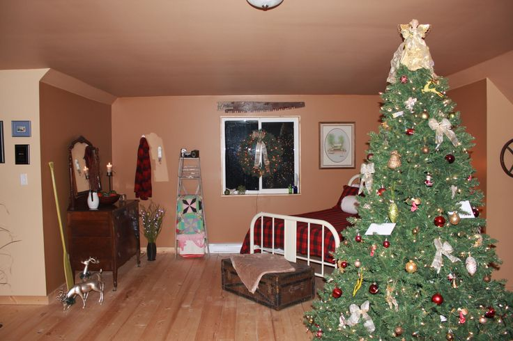 All decked out for Christmas.  The guest bed was changed up to cozy plaid, matched up with a 'bush' jacket hung on the wall.