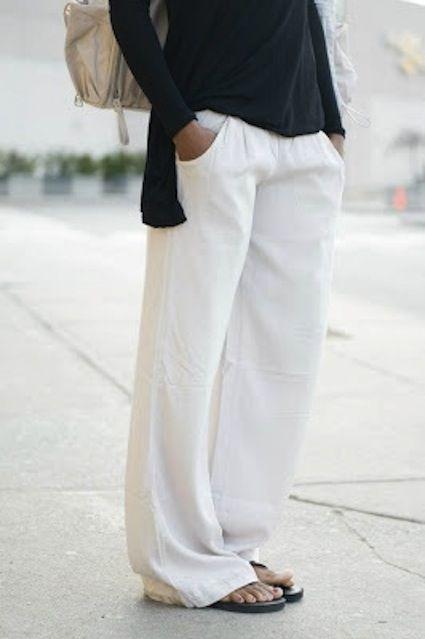 the gold hat.: white linen pants