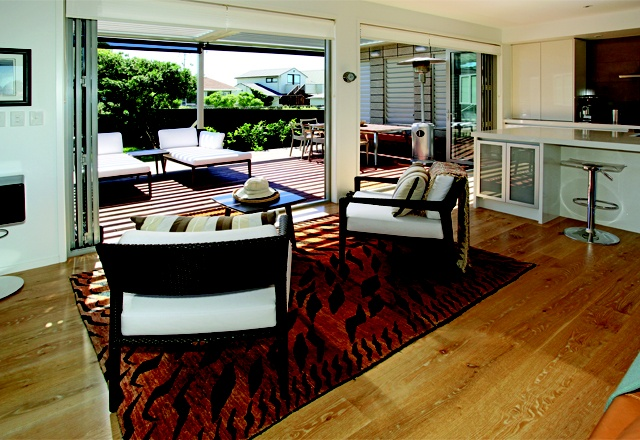 The central living space opens out onto the rear patio area for relaxed holiday living.