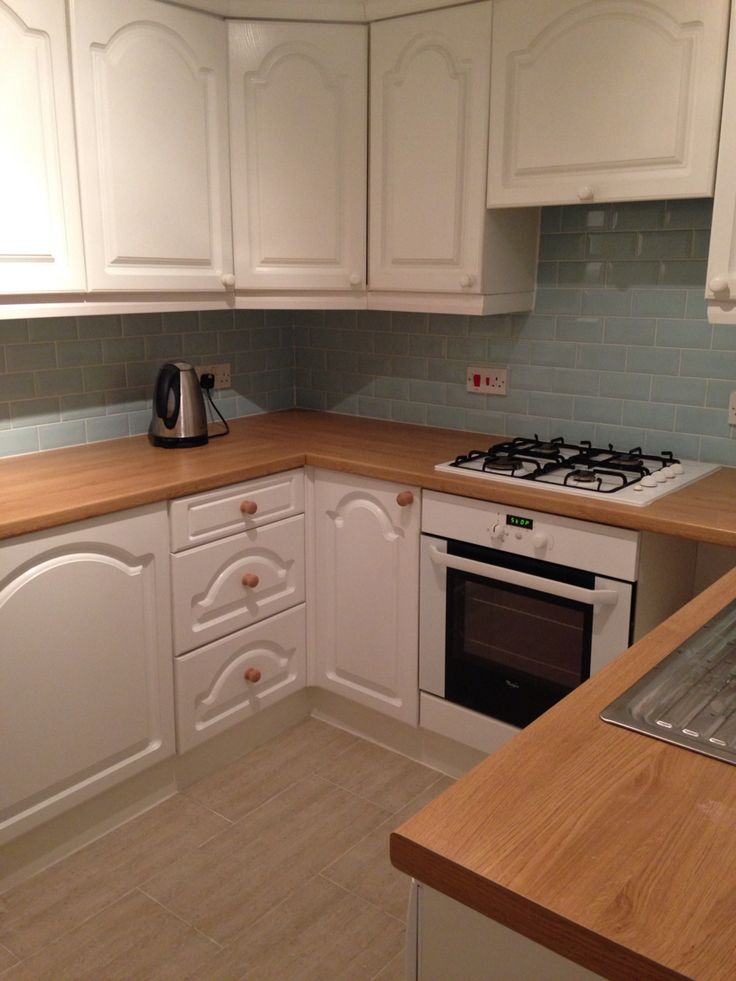 Duck egg blue metro tiles oak worktop white cabinets for Duck egg blue kitchen units