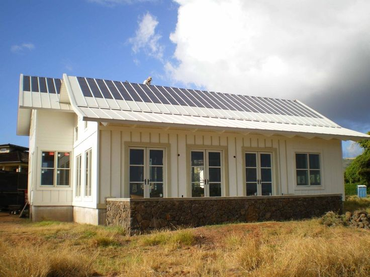 Metal houses uni solar house with pvl laminants and for Tin roof house