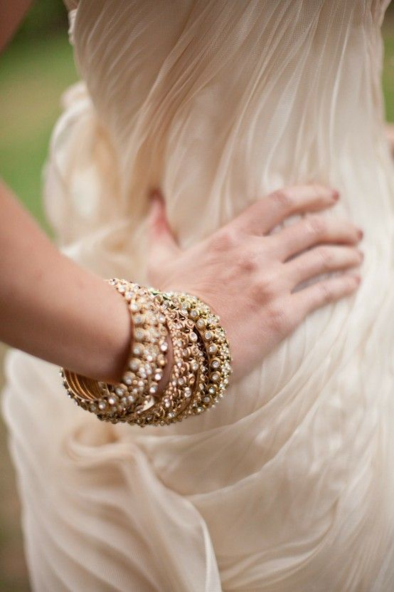 I love a wrist full of bangles...and I love how it keeps the neck open in a lovely wedding gown neckline!