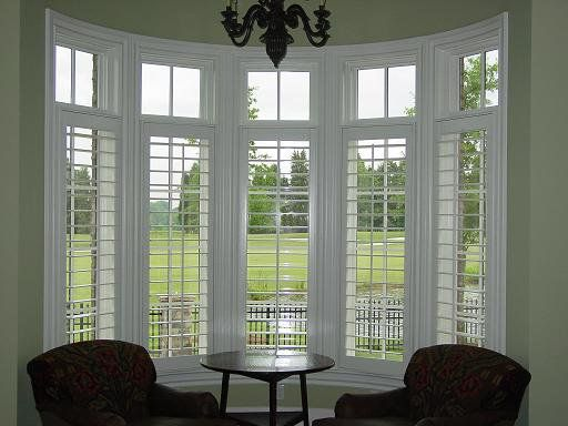 I'd make this a breakfast nook! Love the bay window with plantation shutters