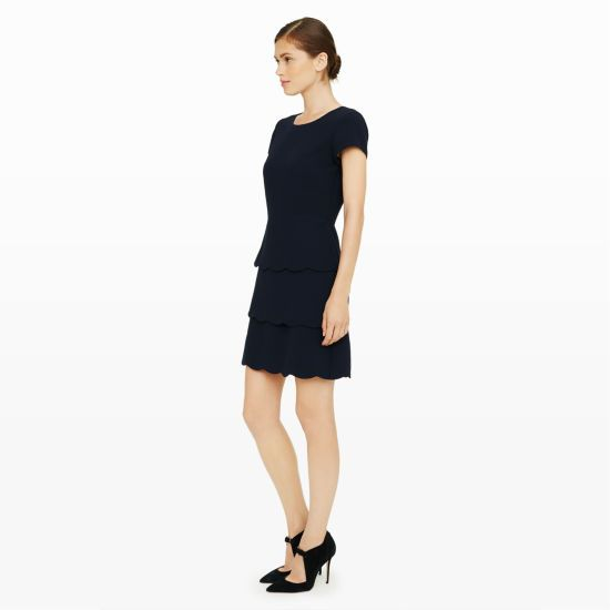 """Sophisticatedly sweet, the Colby dress has a tiered skirt with scalloped hems and a subtly sexy open back for just a hint of skin. Polyester Fit-and-flare silhouette 35"""" in length from high point of shoulder Round neck; cap sleeves; tiered skirt with scalloped hems; darted bust; V-keyhole with single-button closure at back; hidden zip with hook-and-eye closure at back Fully lined Dry clean Imported"""