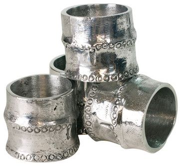 holders for the floral arrangements - silver napkin holders