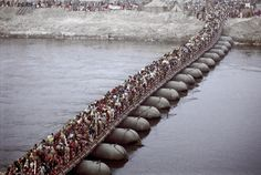 https://flic.kr/p/6pcQxn   INDIA4216/PONTOONS   The stretch of MILLIONS  60 or more across the GANGES THIS IS THE KUMBH MELA in ALLAHABAD. EVERY 12 years in this city. THE LARGEST OF KUMBH MELAS and i was lucky to be there in 2001.  AN AMAZING UNIQUE EVENT HOUSING 60 million people in a small area as this at the same time.  GOD BLESS INDIA