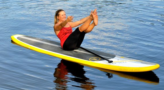 I've been thinking of getting a couple of these paddleboards... this makes it even more intriguing. Pilates program on the board.