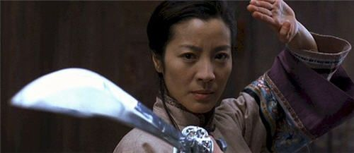 5. Yu Shu Lien (Michele Yeoh), Crouching Tiger Hidden Dragon (2000): Yu Shu Lien is wise and patient. Yu Shu Lien demonstrates strength, character, and restraint. She's a quiet leader and teacher. Better yet, she knows how to use all those scary martial arts weapons. Yu Shen Lien also understands when to give up managing, coaching, and mentoring the bad girl and try to take care of the her with those scary weapons.