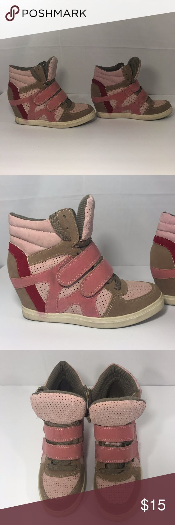 """Guess Wedge sneakers Size 8 GUESS takes the sporty sneaker to new heights with a dramatic hidden wedge and tapered almond toes. Closed-toe lace-up sneakers Velcro strap across vamp with studs around the ankle 3"""" hidden wedge heel Used Mint condition Colors: Pink Light pink Tan Guess Shoes Sneakers"""