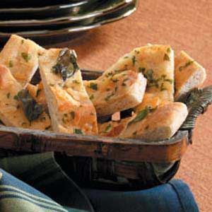 """Basil-Cheese Bread Strips Recipe -Tender and chewy, these bread sticks always go fast. """"My daughters, Jence, Karly and Kourtney, could eat every last one,"""" notes Melinda Rhoads of Slippery Rock, Pennsylvania."""