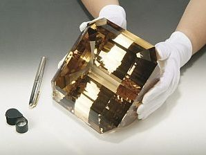 The El-Dorado Topaz, which weighs a whopping 31,000 carats (13.67 lbs.) currently holds the crown as the largest faceted gemstone in the world. Originally discovered in 1984 in mineral-rich Minas Gerais, Brazil, the pre-cut El-Dorado crystal tipped the scales at a mind-boggling 81.57 lbs.