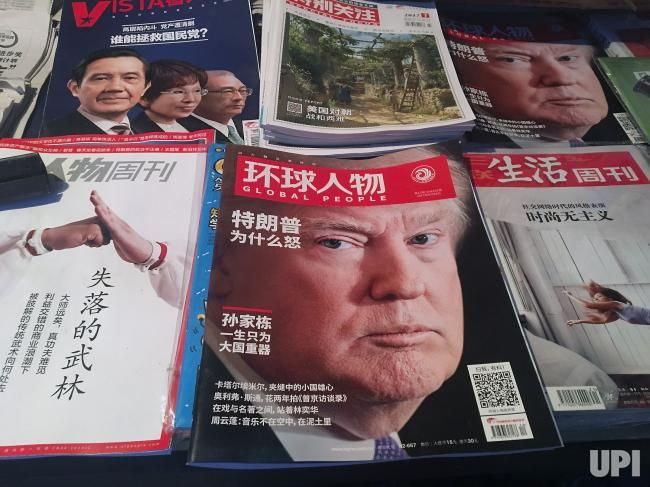 U.S. President Donald Trump is featured on the front page of a popular, political magazine being sold at a news stand in Beijing on June…