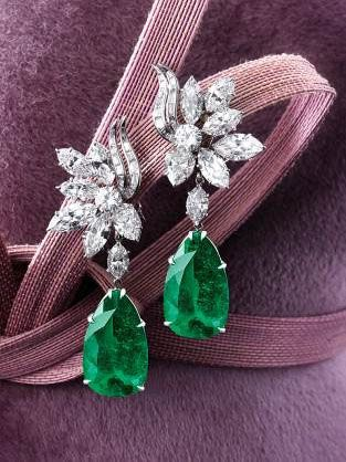 Pair of 16.57 and  14.58 carat Pear-shaped Colombian Emerald and Diamond Pendant Earrings by Harry Winston