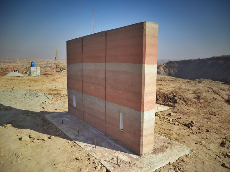 SIREWALL | Structural Insulated Rammed Earth  SIREWALL |Commercial consulting in Islamabad, Pakistan | One of several test walls created as part of our initial prospecting trip. Through a highly refined protocol, we are able to consistently create rammed earth with compression strengths in excess of 20Mpa