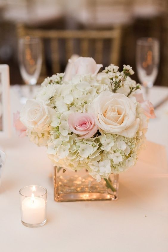 gorgeous wedding centerpiece; photo: Dabble Me This Photography Re-create this beautiful centerpiece with silk flowers and decorations from afloral.com. #diywedding http://www.afloral.com/