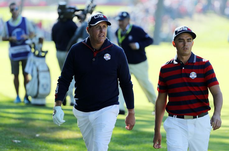 Rickie Fowler Photos Photos - Phil Mickelson and Rickie Fowler of the United States walk to the green during morning foursome matches of the 2016 Ryder Cup at Hazeltine National Golf Club on October 1, 2016 in Chaska, Minnesota. - 2016 Ryder Cup - Morning Foursome Matches