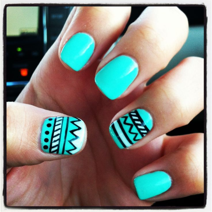 Usually not a huge fan of tribal print nails, but the way it's worked in on accent nails with that color is lovely!