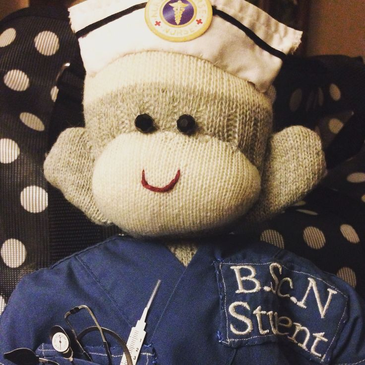 Student Nurse Sock Monkey Special order for the graduating nurse.  Scrubs made from her actual scrubs. Made by The Secret Society of Sock Monkeys