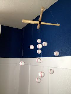 Bringing Vintage Baseball Back- she made this mobile out of bats from Sports Authority and baseballs from Party City!!