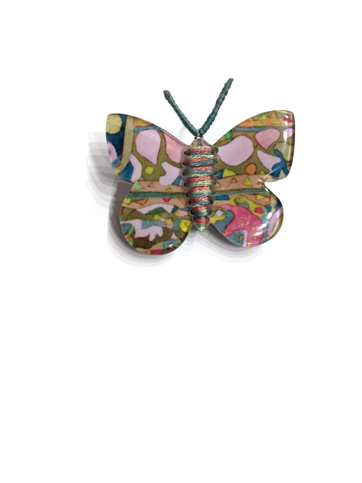 Butterfly resin brooch by One Button #multi #butterfly #springsummer #brooch #accessories #onebutton  Click to see more products from the One Button shop.