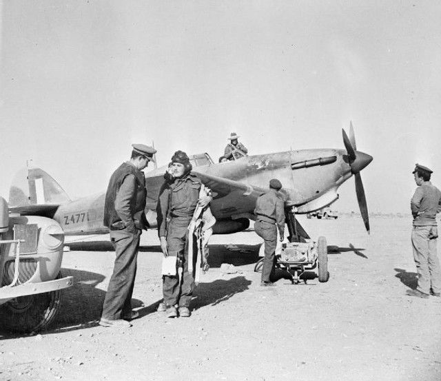 Hawker Hurricane Mk.I, Z4771, 451 Squadron RAF, pilot Sgt R.G. Goldberg, at a landing ground in the Western Desert, after completing a tactical reconnaissance sortie