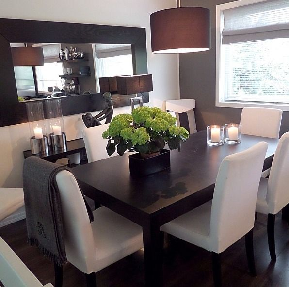 dining room : dark wood table with white cloth chairs. Modern, sleek look. Smaller dining space