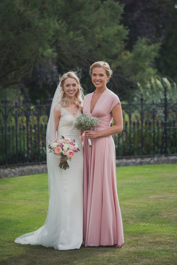 Blush pink twobirds dresses | Bride in a San Patrick Wedding Dress at a traditional wedding in Woolverstone Hall Suffolk. Bridesmaids wear Pink twobirds multiway, convertible dresses and groom in Navy Morning Suit | As seen on Rock My Wedding | Image by Kari Bellamy Photography