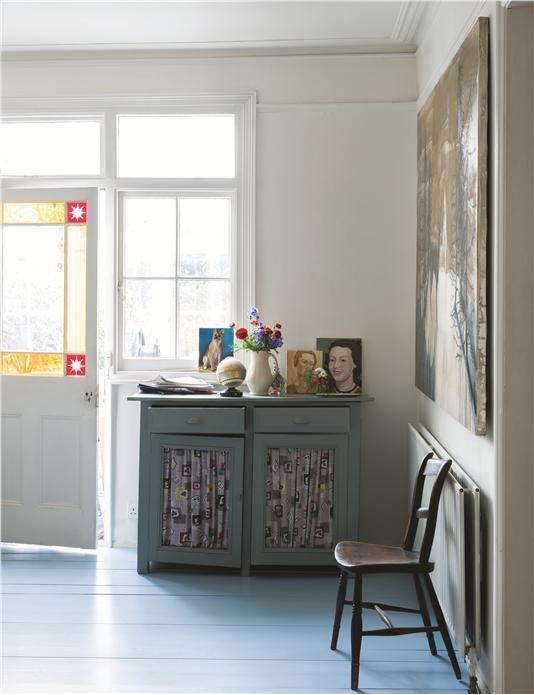 A floor in Farrow & Ball's Lulworth Blue Floor Paint, cabinet in Green Blue Estate Eggshell and door / trim in All White Estate Eggshell.