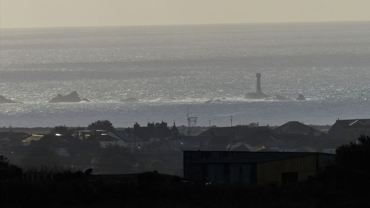 Longship's Lighthouse, Cornwall, 2012.  Lumix FZ200 at full zoom, 600mm equivalent.  The photo was taken about 6 miles, nearly 10km, away.  Amazing technology.  The village is St Just.