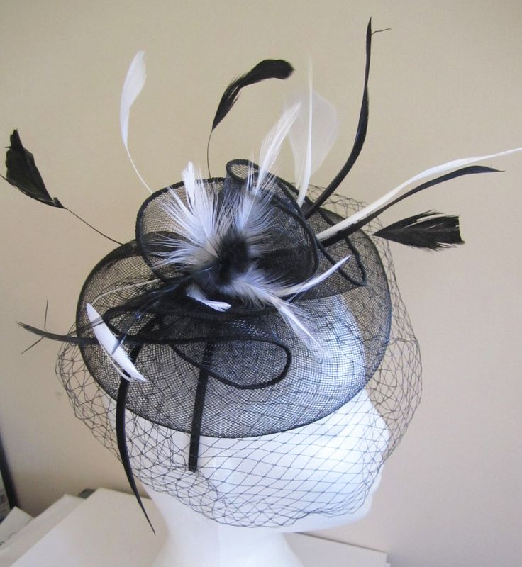 Black fascinator with black & White feathers and netting by WhiteBea